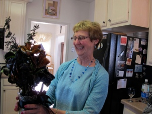 Shirley admiring her black bouquet