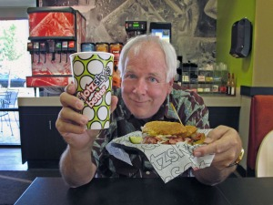 Dick showing off his Schlotzsky's sanwich
