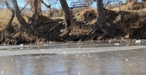 Our tossed ice on the icy river.  You can see how dry the shore is