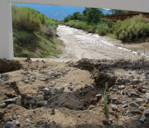 Looking west at some erosion and the same mud laden ditch