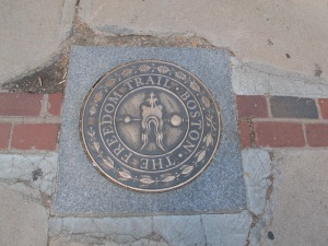 You can see the bricks emanating out of the Freedom Trail marker.