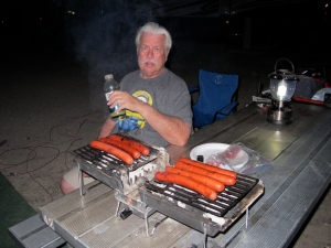 Allan's roasting the perfect hot dogs