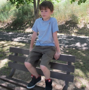 We took a walk along the Snake River and I happened to get a picture of young Alex taking a rest break.