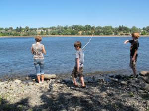 Jerri, Alex and Dalan are checking out the river.