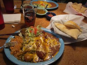 A dish of chile rellenos with the sopapillas on the side.