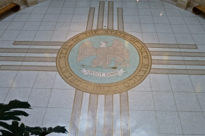 New Mexico's Great Seal in the middle of the Zia symbol