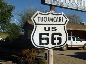 An old Route 66 sign in front of an abandoned motel.