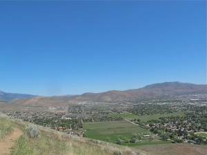 Looking northwest. The white buildings in a row at the base of the mountain/hill in the center are the Carson Tahoe Hospital.