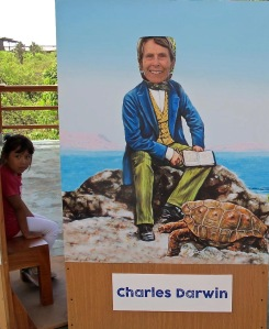 A modern day Charles Darwin with a little girl checking out the situation.