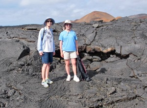 Shirley and I are standing in front of lava with different colored minerals showing.