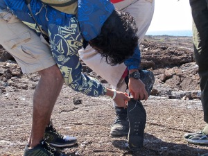 While we were walking over rocky path, one of our new friends, Lydia, had a flat tire… the sole of her shoe came undone and Erick helped her take the entire sole off the shoe. A few minutes later, the other one detached itself. I don't know why this happened but it was cause for much laughter and teasing.