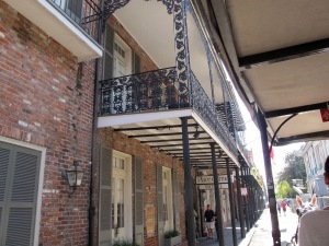 "French Quarter buildings fascinated me and I could have taken pictures of them all day long. Iron lace balconies, sweeping fan-like windows and traces of French and Spanish influence comprise ""Creole"" architecture."