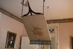 A shoo fly over the dining room table