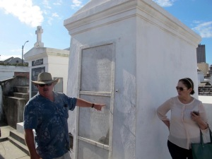 Our carriage driver is pointing to the Glapion family tomb where the remains of voodoo queen Marie Laveau are said to rest. You can see in the background that there are many shapes and sizes of tombs in the cemetery.
