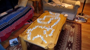 Dalan went to spend the night with a friend and Megan stayed with me. Our last activity before going to bed was this domino train we built. Megan is really good at it and can make them fall just perfectly. Some are still standing because this is an action shot.