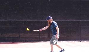 Scott returning a ball.